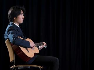 International Student Playing Guitar