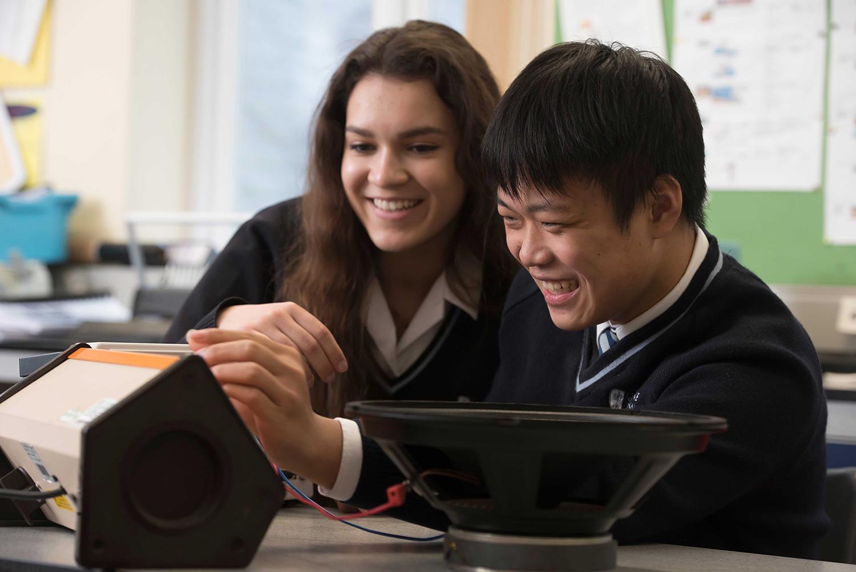 Two international school students in science class