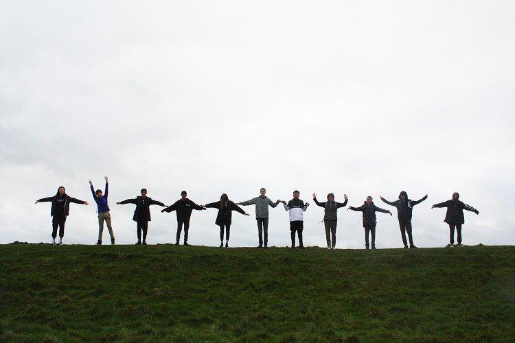 Sherborne International students Running on Maiden Castle